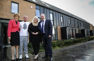 New residents at Glasgow's Commonwealth Games legacy housing with the First Minister and leader of Glasgow Council. Photo by the First Minister's Office.