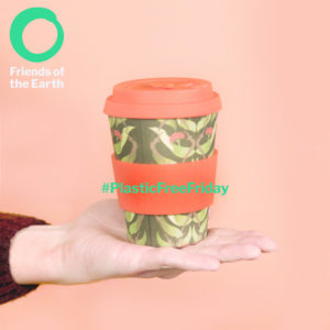 Reusable coffee cup on a peach background
